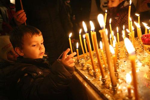 Children light candles at Christmas Mass Credit haak78 Shutterstock CNA